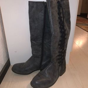 Grey and black tall boots